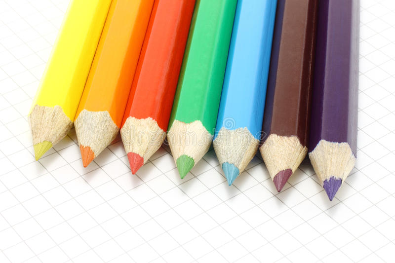 Big colour pencils on the notepad royalty free stock images