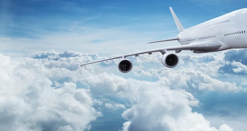 Big commercial airplane flying above dramatic clouds. stock image