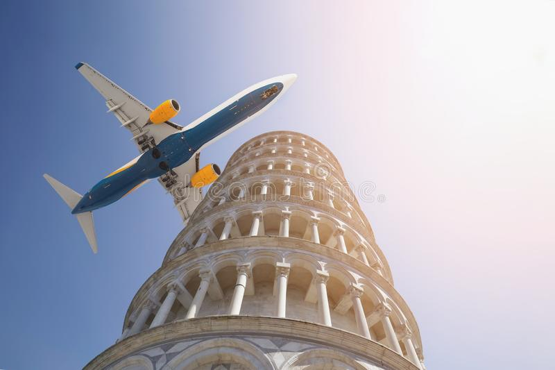 Big commercial passenger airplane flying over leaning tower of Pisa in Italy on bright sunny day. Visit Italy concept. Travel to. Italian historical city of stock images