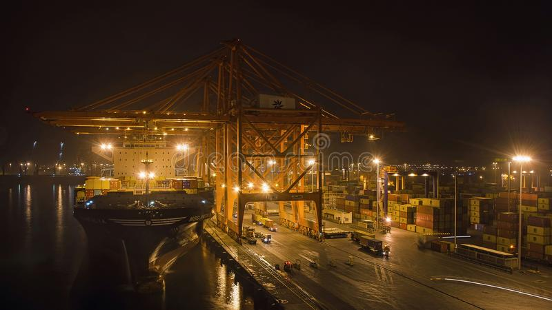 A big container ship is loading cargo in the port royalty free stock photography