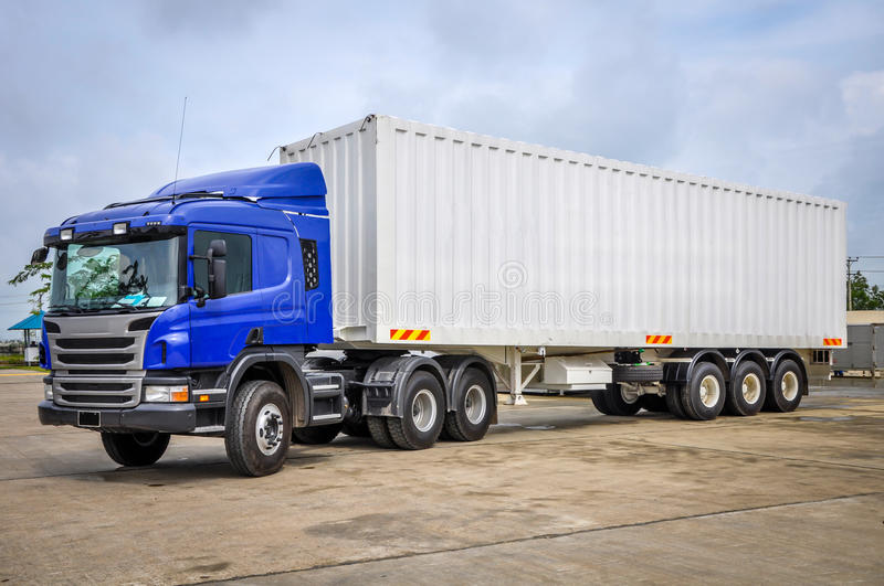 photo of big tractor, with container trailer, to deliver goods and products stock photos