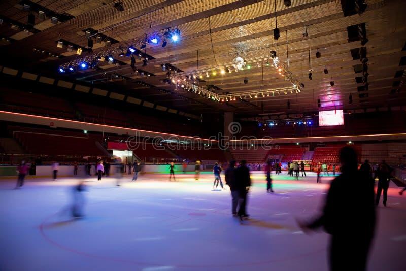 Big covered skating rink with illumination stock photo