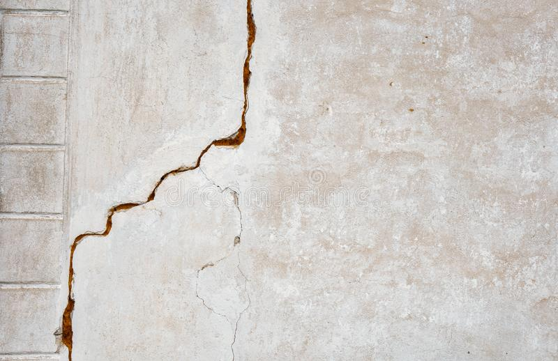 A big crack on the gray wall. abstract image projecting a crack in a white concrete wall. Background grunge design frame retro pattern vintage texture royalty free stock photo