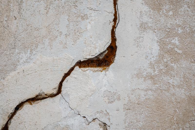A big crack on the gray wall. abstract image projecting a crack in a white concrete wall. Background grunge design frame retro pattern vintage texture royalty free stock photos