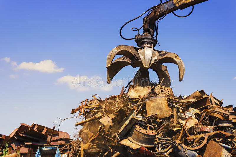 Big crane dropped scrap on pile. A little dust is visible. Copy space available stock images