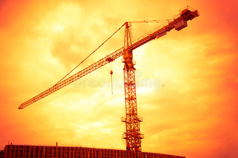Download Big Crane On Sunset Orange Sky Background Stock Image - Image: 24325299