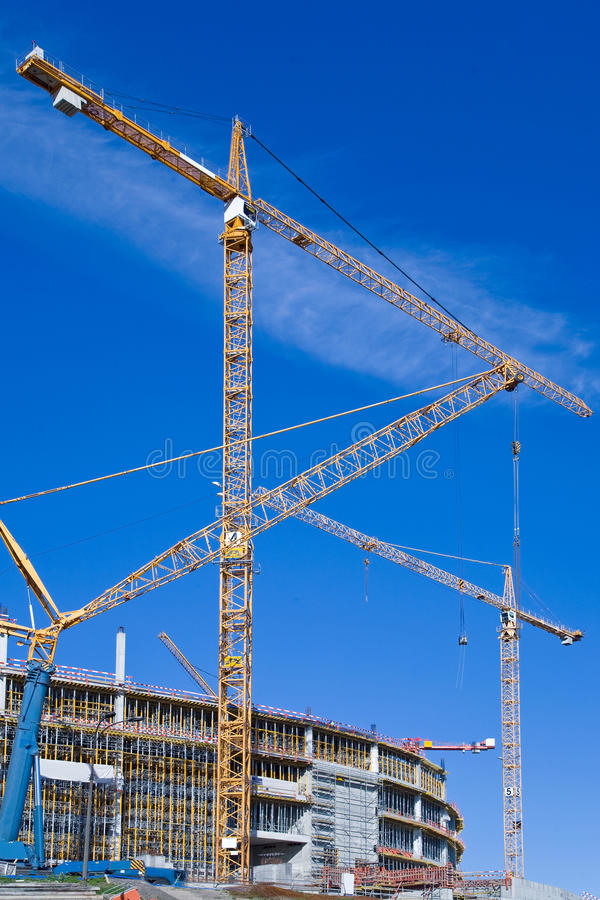 Big cranes on a construction site royalty free stock images
