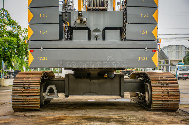 Rear view of big crawler crane, counterweights and big chain royalty free stock photos