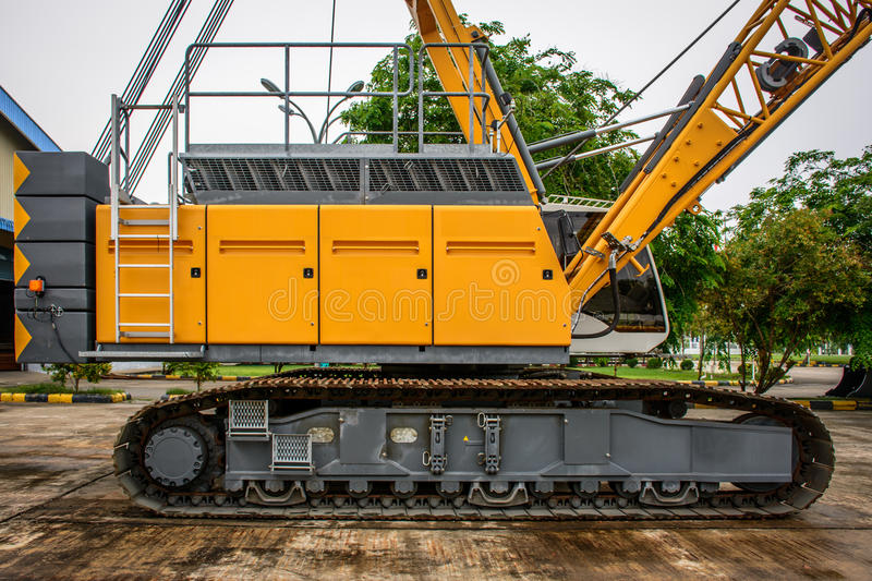 Side view of crawler crane, counterweights, big chain and arms stock photos