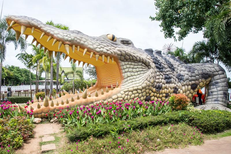 Big crocodile statue in public park of Bueng See Fai, Phichit Province, Thailand. Phichit, Thailand - 9 July 2017 : Big crocodile statue in public park of Bueng royalty free stock photography
