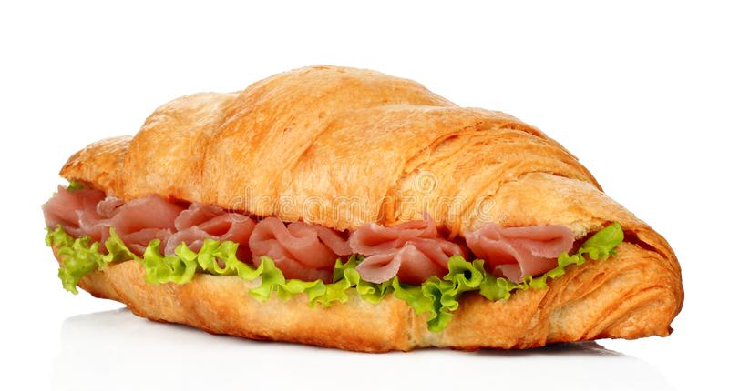 Big croissant with green salad and pork meat royalty free stock photo