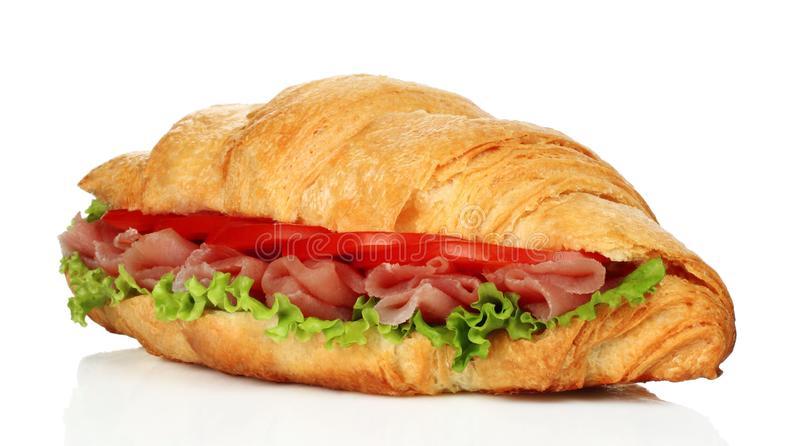 Big croissant with green salad and pork meat royalty free stock images