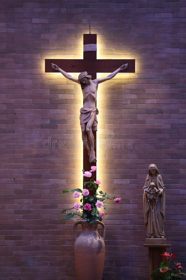 A big cross with Jesus in the Catholic church. royalty free stock photo