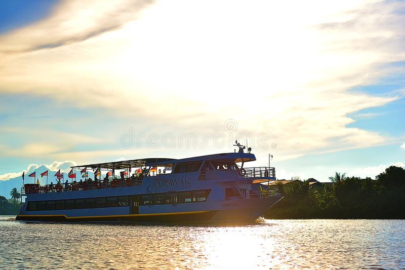 A Big Cruise Ship Carrying Tourists Pass By My Small Boat royalty free stock images