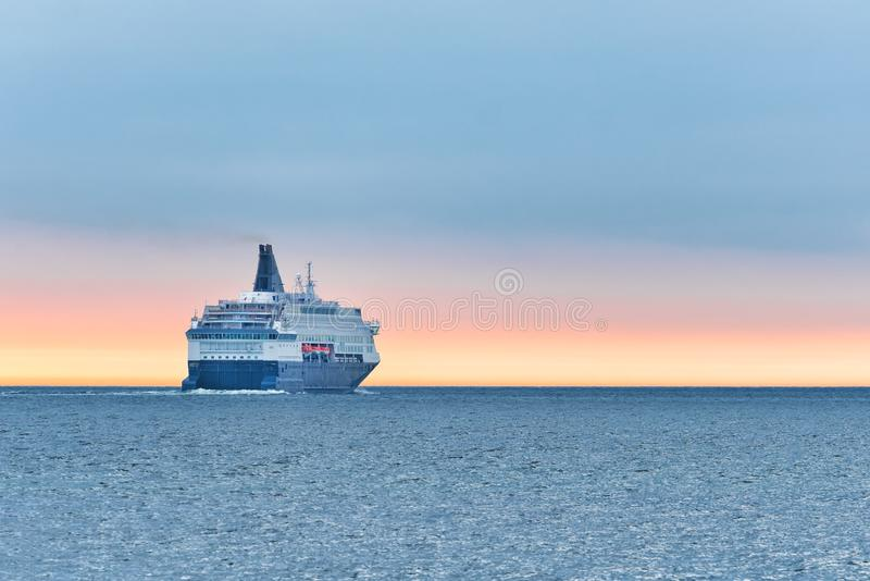 Big cruise ship in the sea at sunset. Beautiful seascape. Image, tourism, travel, vacation, water, white, luxury, sky, summer, vessel, liner, passenger, sail stock image