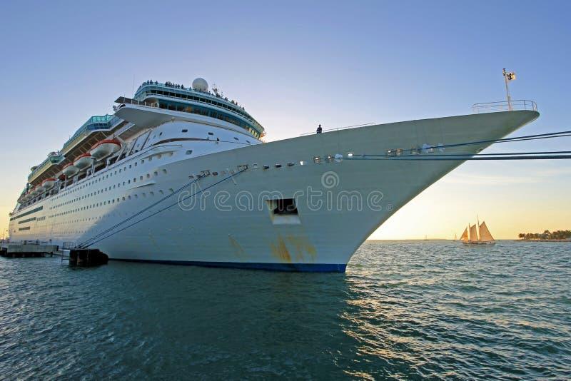 Big cruise ship and small sailing boat, size comparison, Key West, Florida, USA stock photography