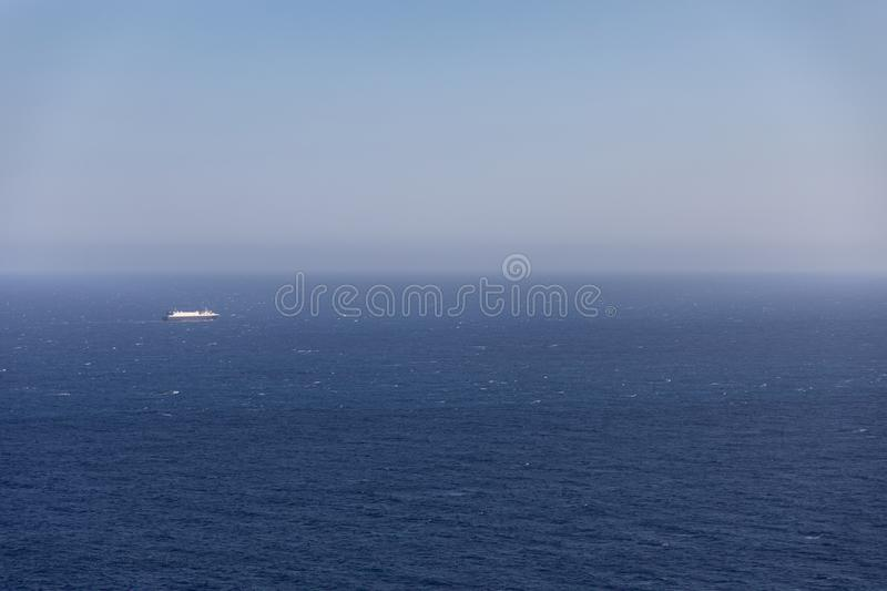 Big cruiser boat far on the horizon royalty free stock photos