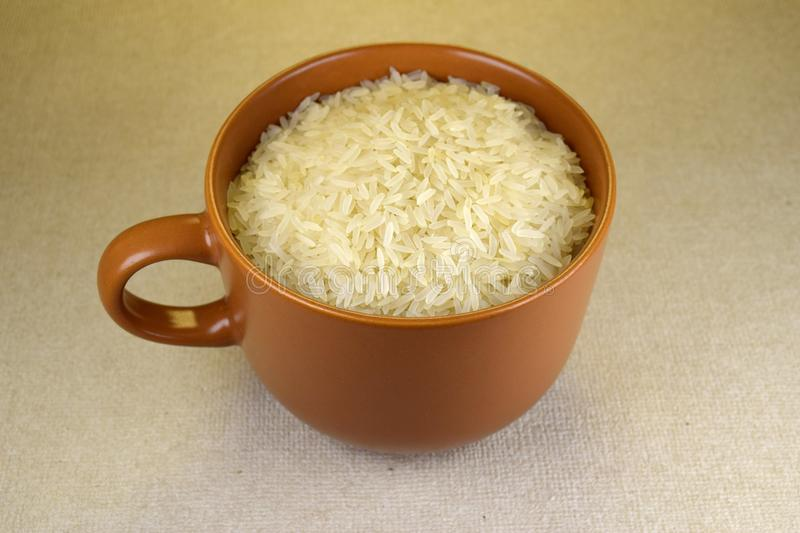 Big cup of rice stock photography