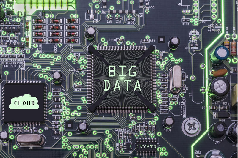 Big data and ccloud. Closeup of electronic circuit board with processor with cloud symbol and phrases big data, cloud and crypto stock photo