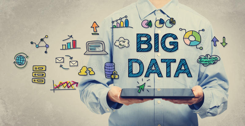 Big Data concept with man holding a tablet royalty free stock image