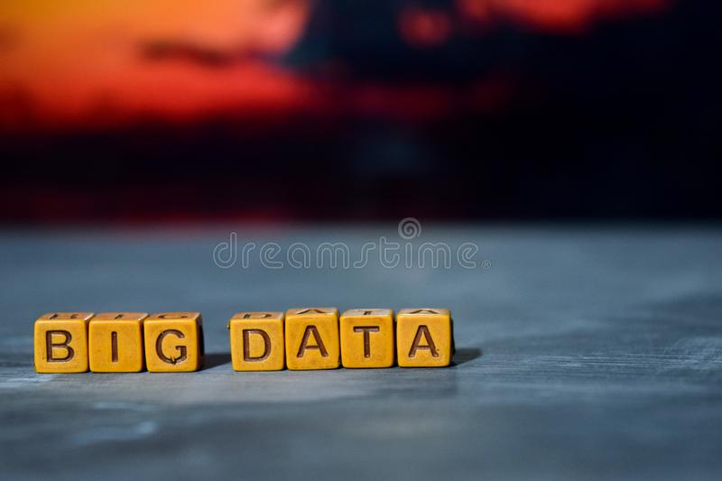 Big data on wooden blocks. Cross processed image with bokeh background royalty free stock photography