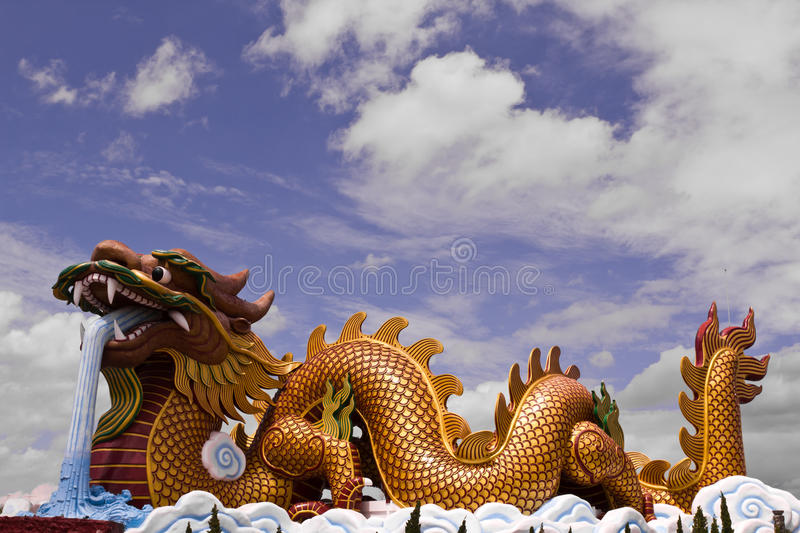 Big dragon statue. And blue sky with cloud in Thailand stock photos
