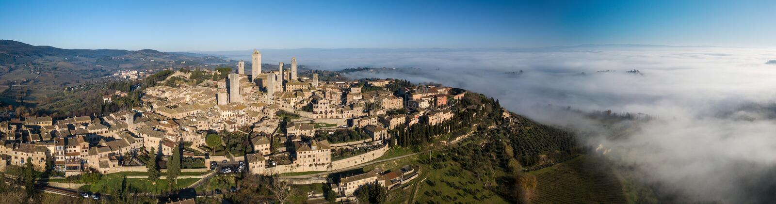 Big drone aerial landscape panorama of the wonderful village of San Gimignano a small walled medieval hill town in the. Province of Siena, Tuscany in morning royalty free stock photos