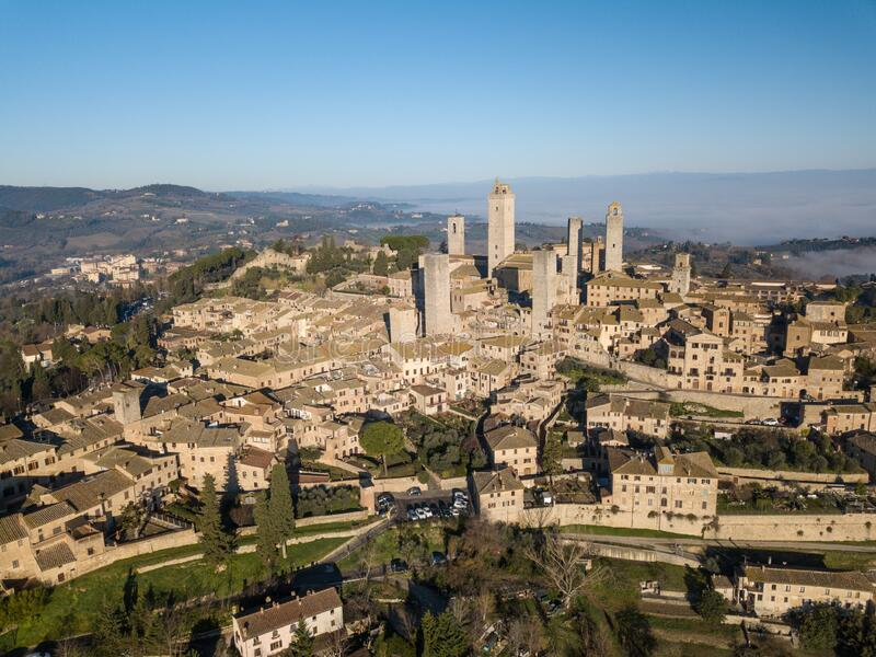 Big drone aerial landscape of the wonderful village of San Gimignano a small walled medieval hill town in the province. Of Siena, Tuscany in morning mystic fog stock image