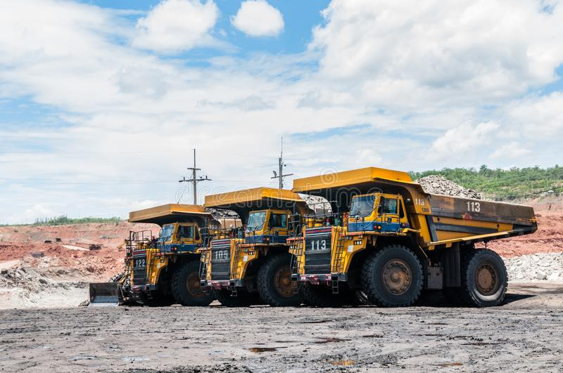 Big dump truck is mining machinery, or mining equipment to trans royalty free stock images
