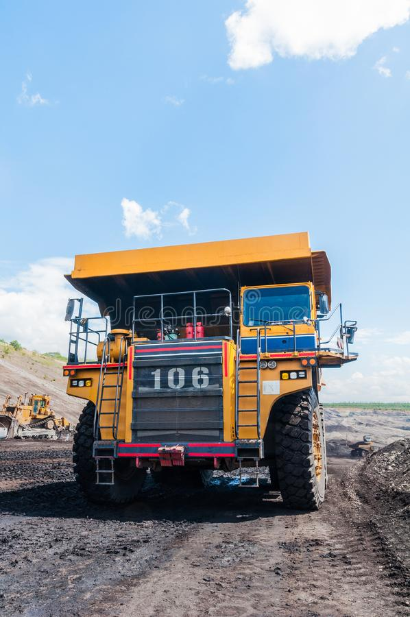 Big dump truck is mining machinery, or mining equipment to trans royalty free stock photo