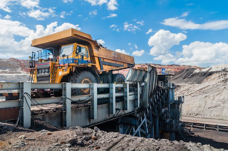 Big dump truck is mining machinery, or mining equipment to trans royalty free stock photography