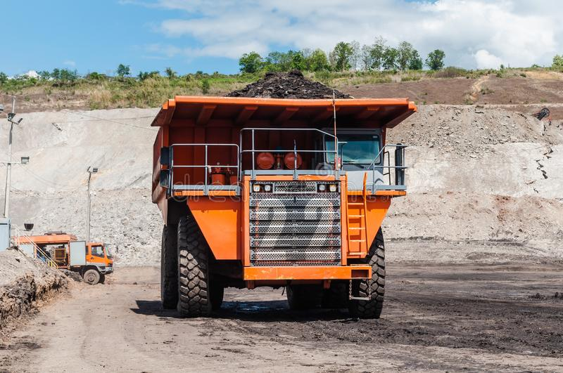 Big dump truck is mining machinery, or mining equipment to trans royalty free stock photos