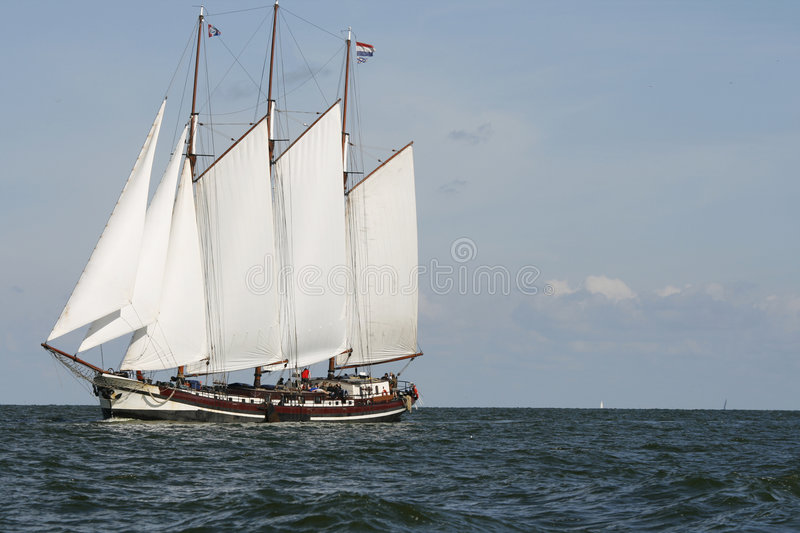Big Dutch traditional sailing ship on ocean stock image