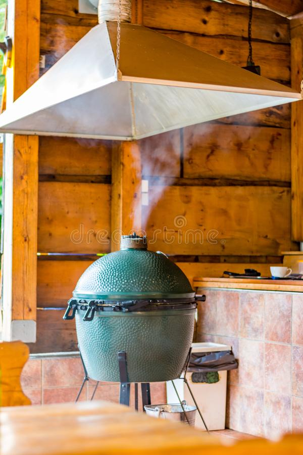 Big egg grill device. Smoking grill in the restaurant.  stock images