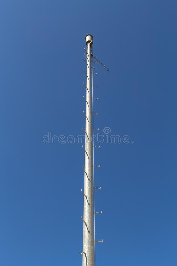 Big electricity pole. With blue sky in the background stock photography