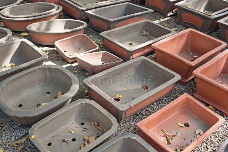 Big empty bonsai pots on garden stones. Big empty bonsai pots on a ground with garden stones stock photo