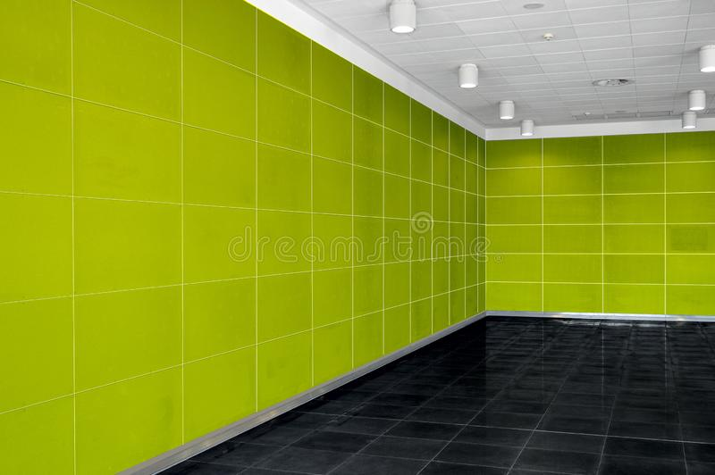 Big empty room interior with bright green wall, whire ceiling an stock photos