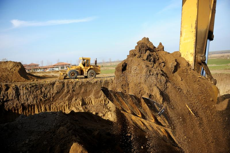 Excavator on construction site stock images