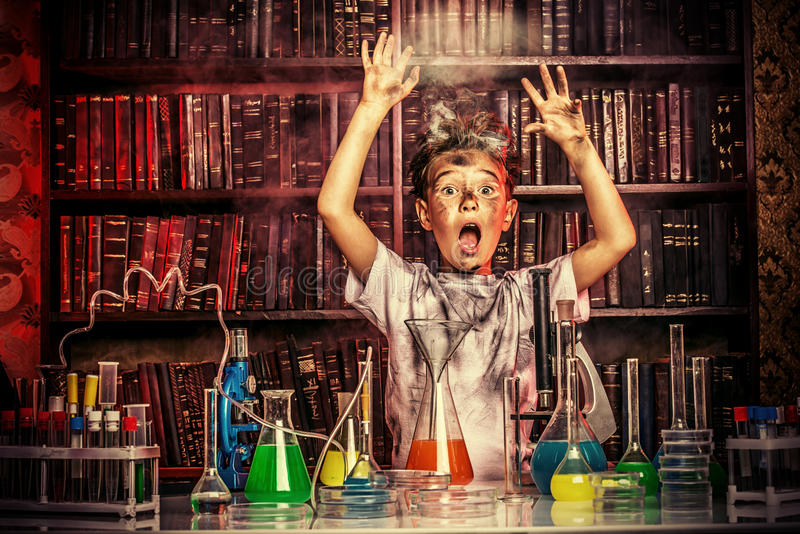 Big explosion. A boy doing experiments in the laboratory. Explosion in the laboratory. Science and education royalty free stock photo