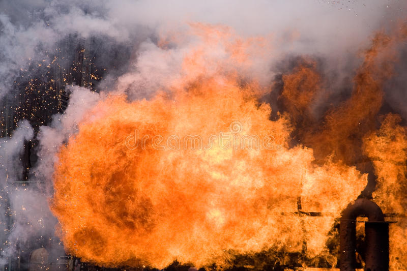Big explosion in a industry plant. An industrial plant explodes in a giant fire ball royalty free stock photo