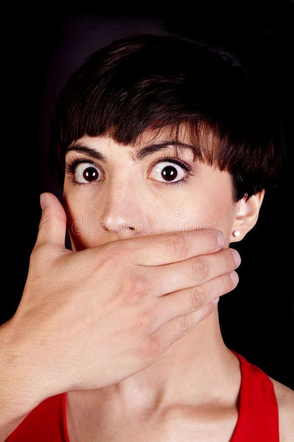 Big Eyes With Hand Over Mouth Royalty Free Stock Photography