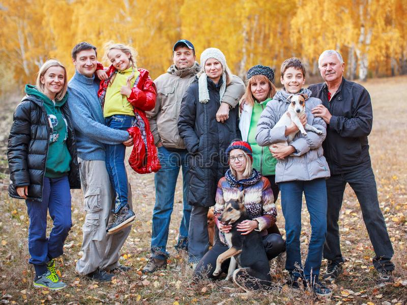 Big family at autumn. Parent with children outdoors stock photo