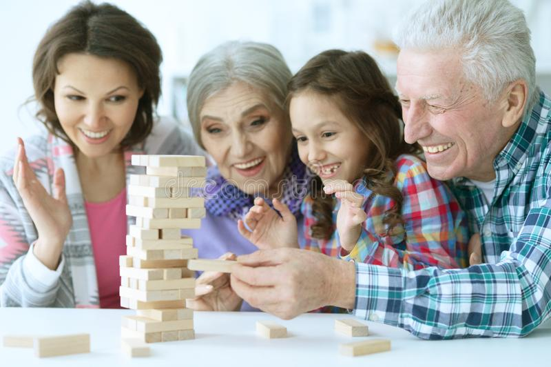 Big family with cute little girl playing with wooden blocks stock photography