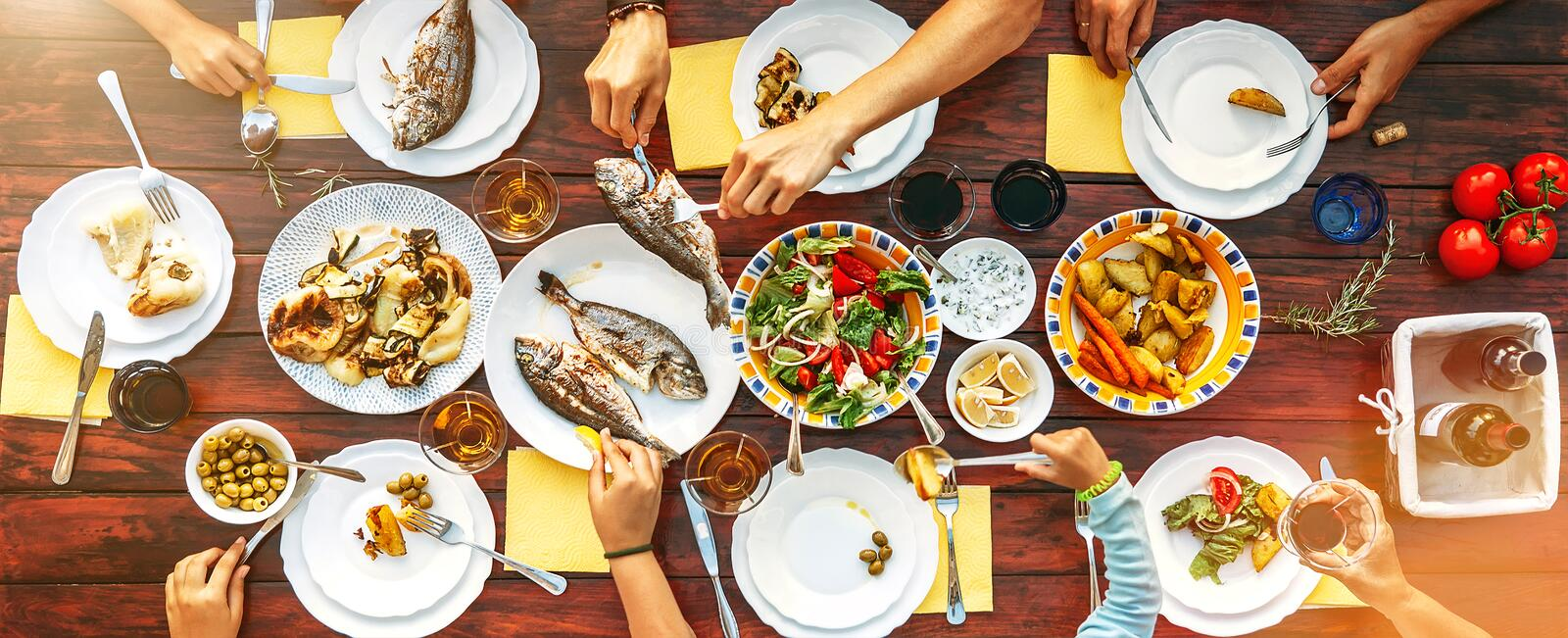 Big family dinner in process. Top view vertical image on table w stock image