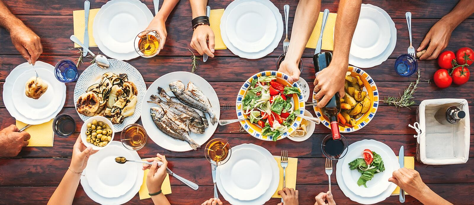 Big family dinner. Top vertical view on the table with dishes an stock photo