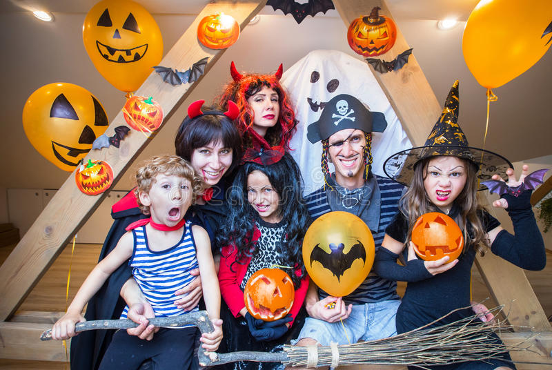 Big family in halloween costumes royalty free stock photos