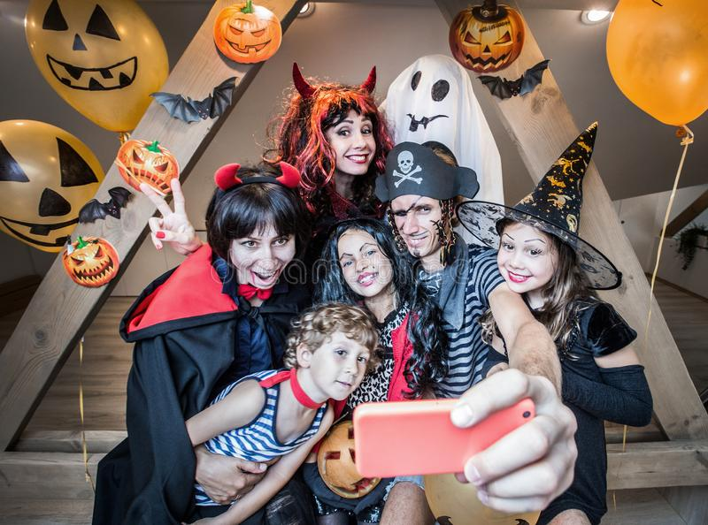 Big family in halloween costumes royalty free stock image