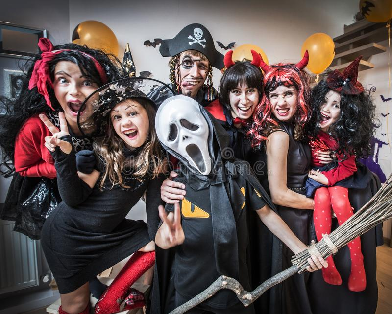 Big family in halloween costumes stock photography