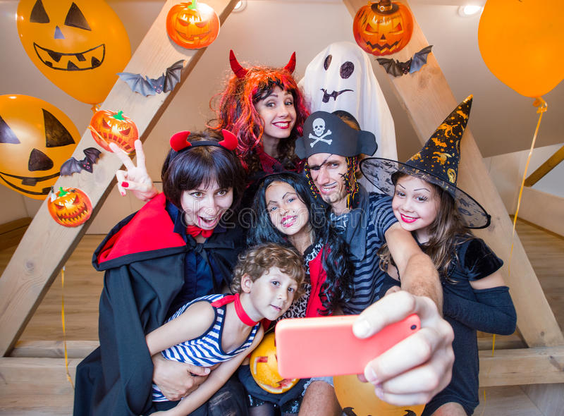 Big family in halloween costumes. Big family makes selfie in halloween costumes stock photography
