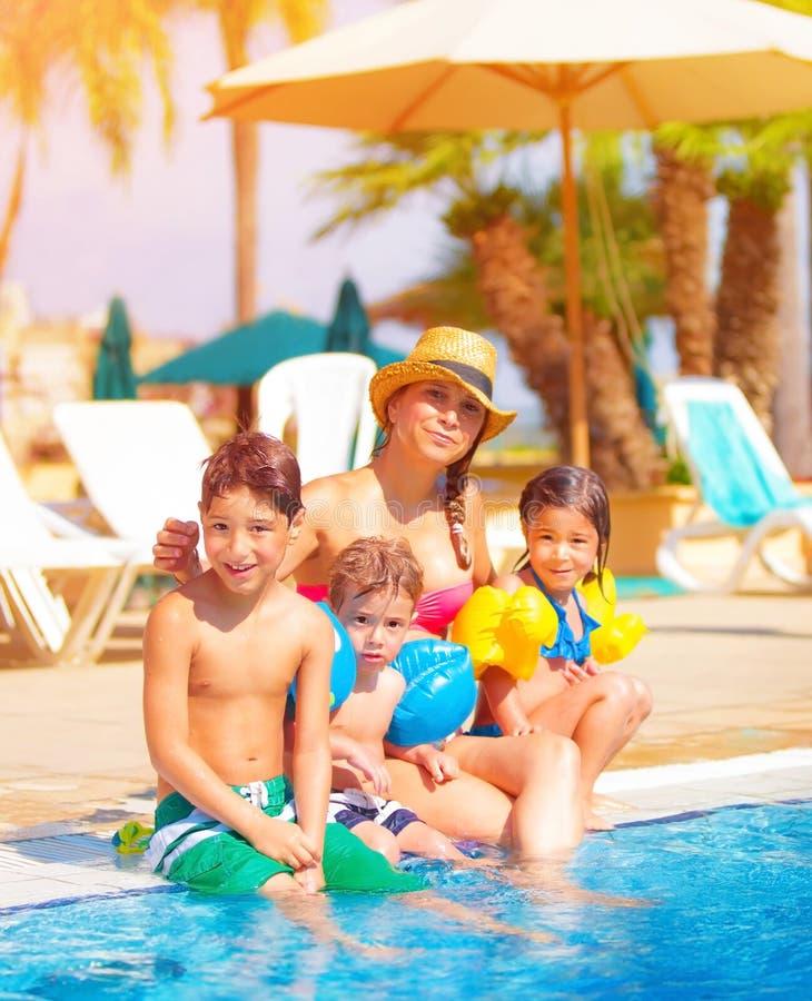 Big family near poolside royalty free stock photos